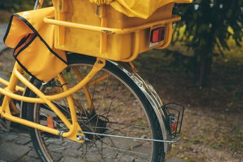 A yellow mail bike Bicycle Mail Postman postal delivery Postal Bicycle Yellow German Post