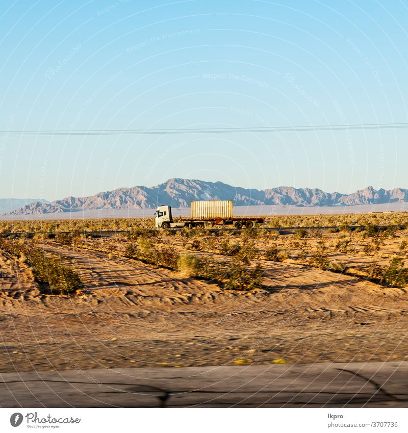 in iran   mountain landscape rock desert nature persia travel sky asia stone scenic hill valley tourism view road panorama green transport scenery beautiful