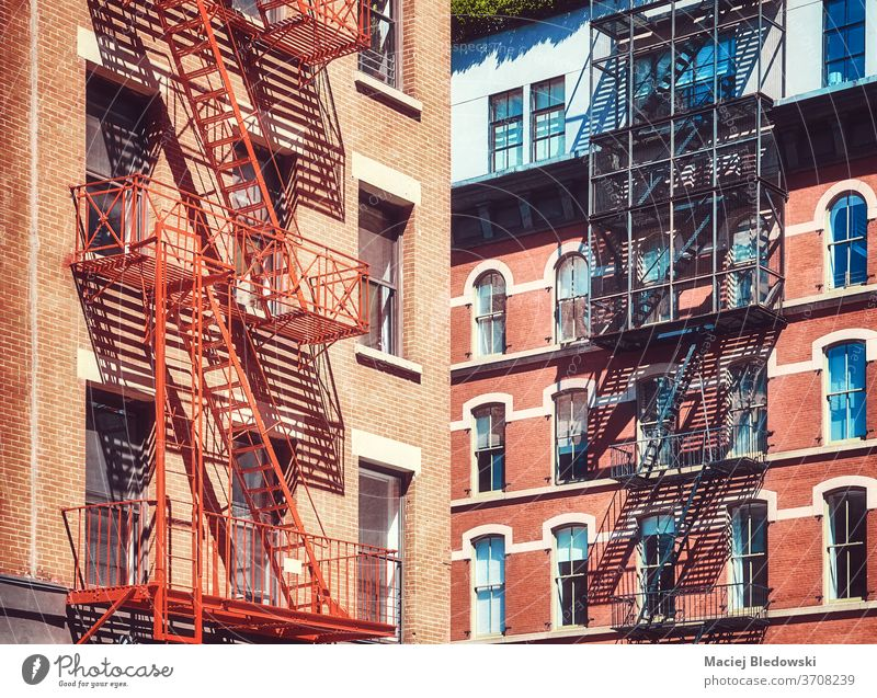 Old residential buildings with fire escapes, New York City, USA. city Manhattan old stairs apartment house NYC urban architecture America exterior window