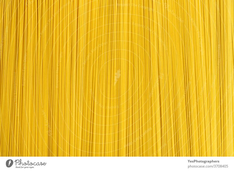 Raw spaghetti abstract background. Uncooked pasta top view. Pile of spaghetti above view carbohydrate carbs close-up comfort food cooking cuisine culinary
