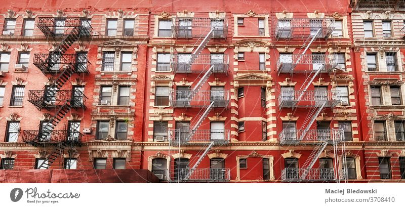 Old residential red building with fire escapes, New York. city Manhattan old stairs apartment house NYC urban USA architecture America exterior window tenement
