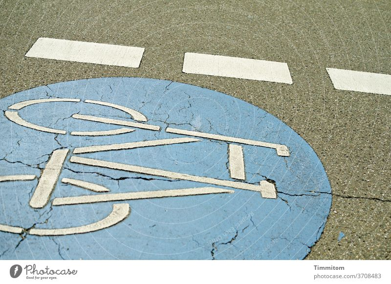 Unconventional road marking in a slight inclined position Lane markings Signs and labeling Signage Bicycle bicycle lane demarcation Colour areas of colour Gray