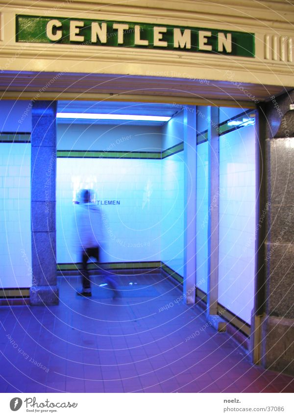 MAN'S TOILET, BLUE. Public restroom Gentleman Gentlemen's toilet Man Blur Motion blur Transport blue light