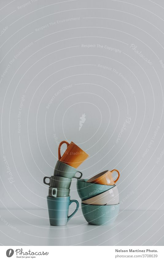 Minimalist and abstract composition with cups and deep plates. They are in a white background. copy space think straight idea concept minimal creative pastel
