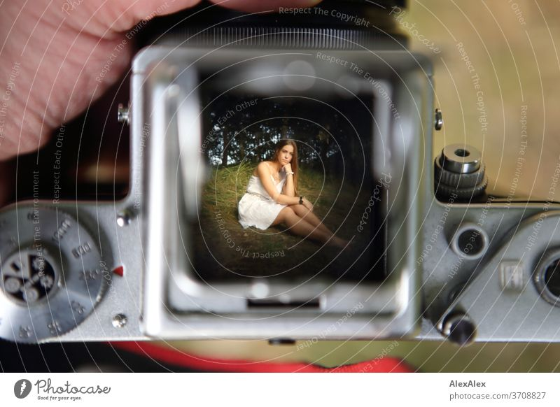 View of the light shaft of an analogue camera at the picture of a young woman with white dress in nature Light Athletic Feminine Emotions emotionally portrait