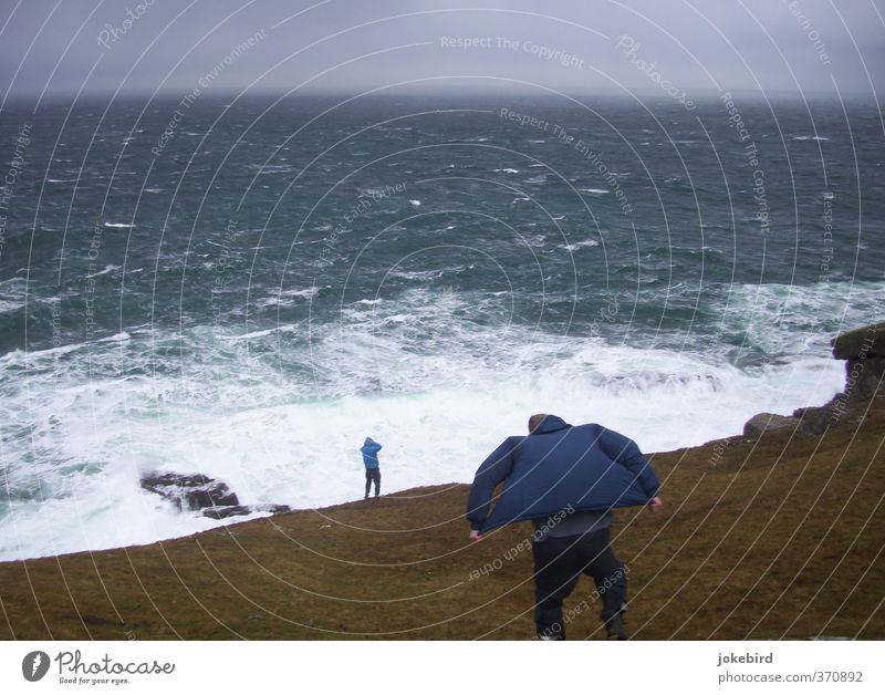 Fight against the forces of nature Human being Masculine Gale Waves Coast Ocean Cliff Pants Jacket Hooded (clothing) Unwavering Force of nature Atlantic Ocean