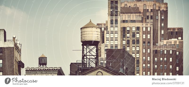 New York City old architecture with rooftop water tanks. city water tower retro building NYC USA symbol Manhattan picture view filtered faded panorama vintage