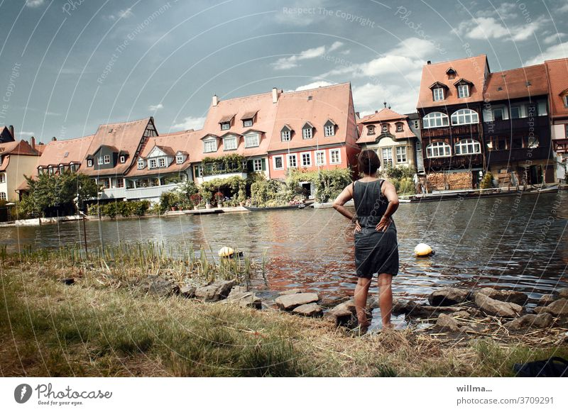 Holiday in Little Venice Bamberg Old town Regnitz river River Woman River bank Summer vacation Housefront