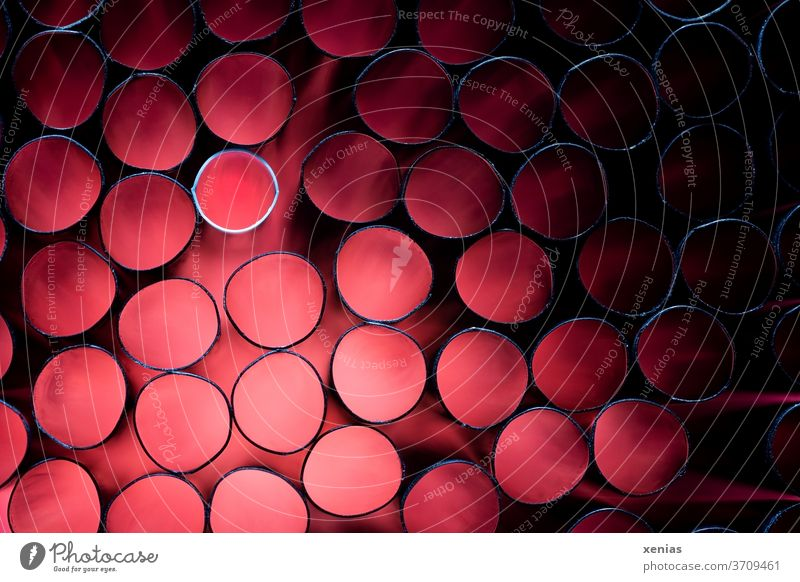 Many black and one white straw with red light Red Straw pipes Black White Ring Shallow depth of field Artificial light Studio shot Plastic Round Light