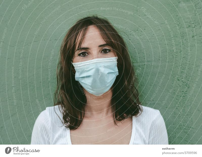 Close-up of young woman wearing medical mask coronavirus epidemic pandemic quarantine covid-19 symptom medicine health background blur positive test hospital
