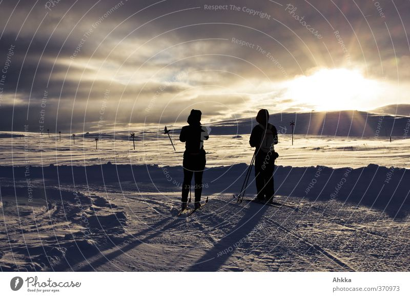 Two people in the sun before an evening winter landscape Exotic Harmonious Well-being Calm Adventure Freedom Expedition Winter Snow Mountain Nature Landscape
