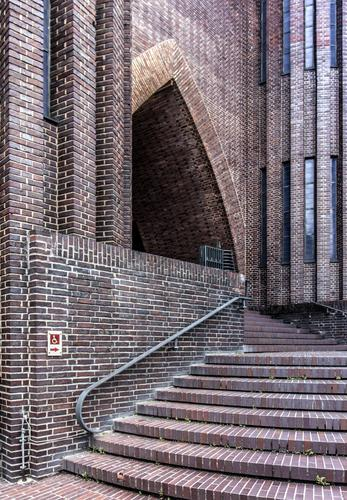 A staircase leads to the beautiful portal of the church Church stagger Entrance Stairs Brick Portal Disability friendly barrier-free obstacle Detour