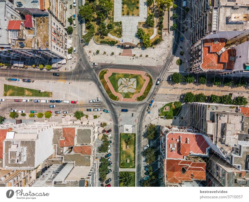 Thessaloniki, Greece aerial drone view of Agia Sofia square. Day top panorama of a European city with buildings around road & pedestrian area.