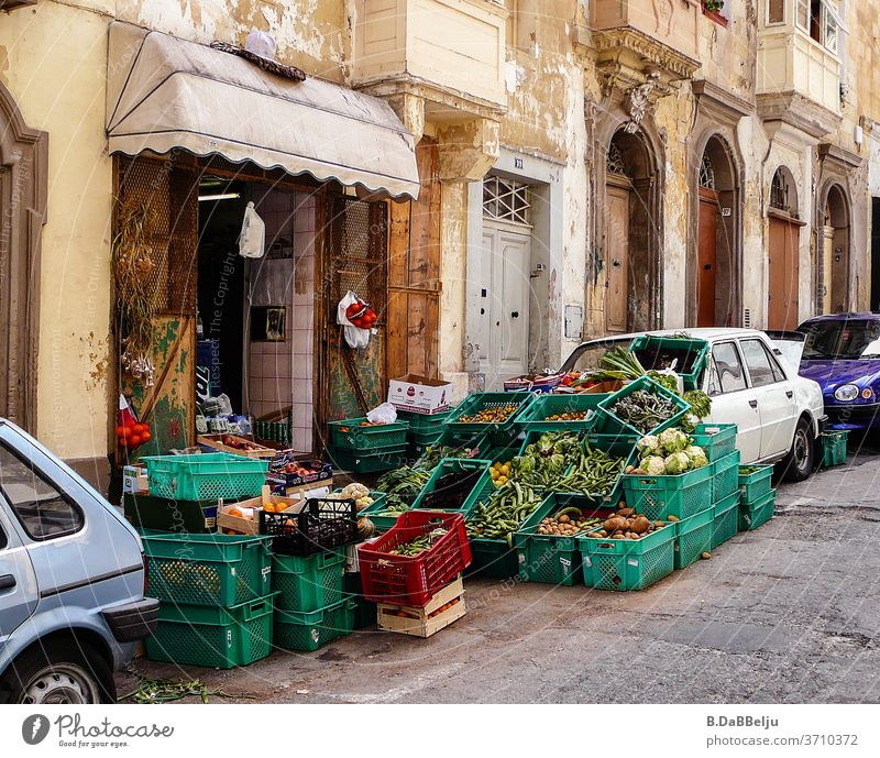 The greengrocer in Valletta (Malta) uses everything to present his goods. Valetta Greengrocer Old town Vegetable Fresh Nutrition Food Street Scene Markets