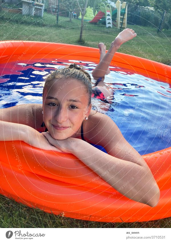 Girl in a paddling pool girl Water Blue Summer vacation Relaxation Swimming pool Woman Swimming & Bathing Exterior shot Wet Feminine Reflection at home