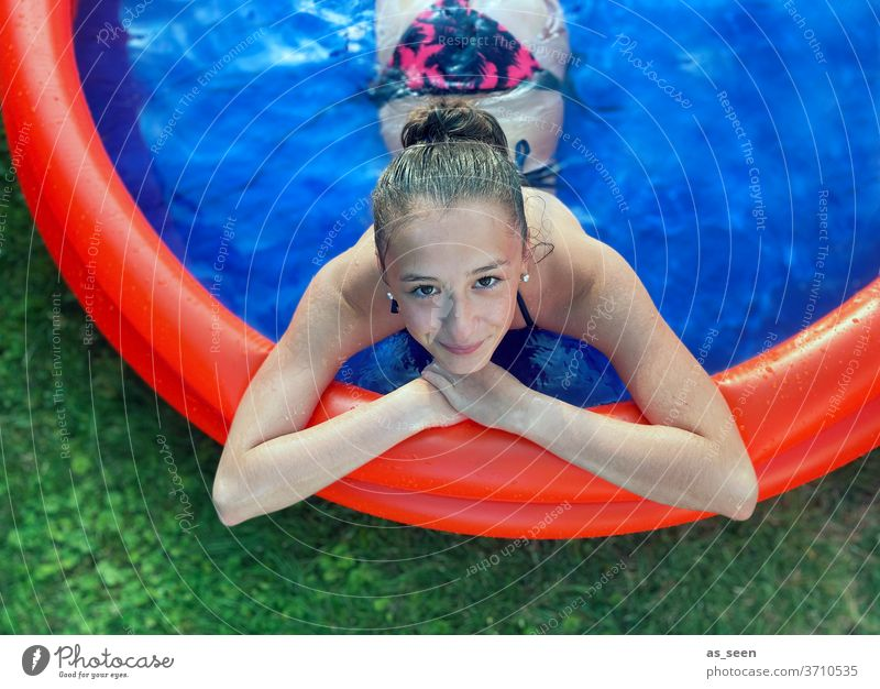 Girls in the paddling pool from above girl Water Blue Summer vacation Relaxation Swimming pool Woman Swimming & Bathing Exterior shot Wet Feminine Reflection
