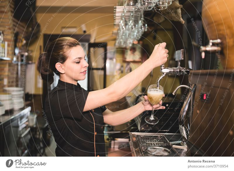 Waitress tapping faucet beer in bar waitress pub woman 30-35 years Adults Alcohol Andalusia Bartender Glass Caucasian Color Image Dishes Drink