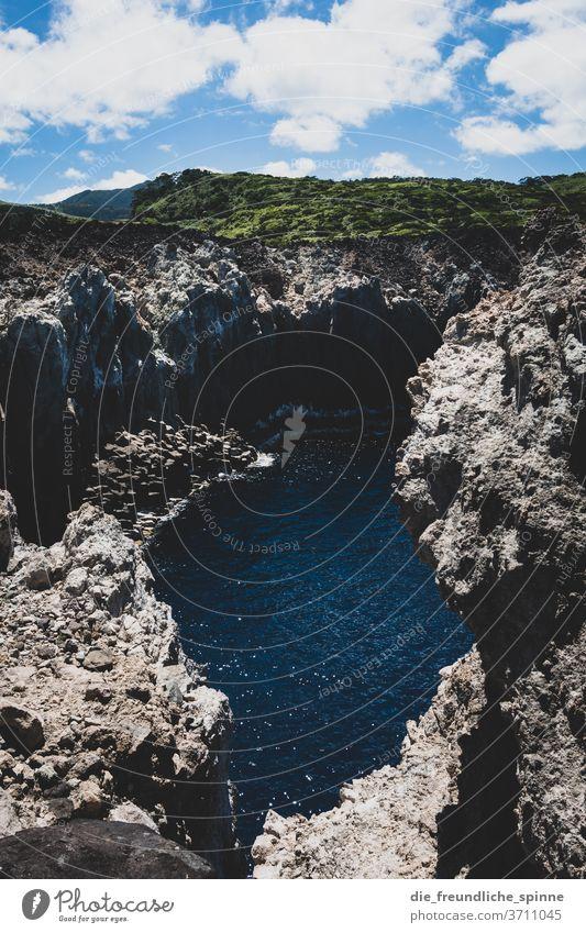 Azores Coast I Ocean Atlantic Ocean Stone Volcano green Sky Clouds Deserted Nature Water Blue Rock Exterior shot Colour photo steep coast Landscape Waves stones