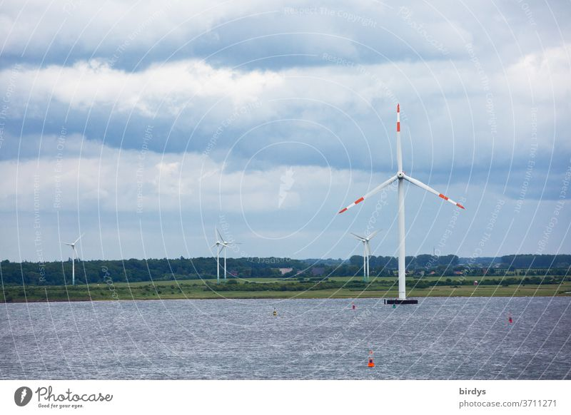 Wind energy, wind turbines on land and on water Wind energy plant Renewable energy wind power Pinwheel Energy industry Environmental protection Climate change