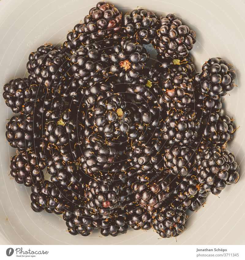 white bowl with fresh blackberries on wood berry Berries blackberry Blackberry Eating fruit fruits Close-up food Blue out colourful low fructose Gaudy Delicious