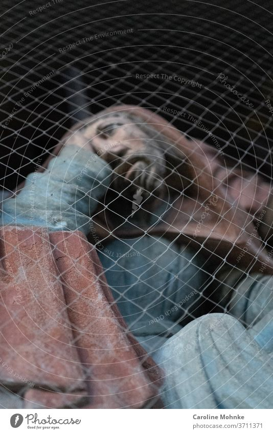 Jesus figure behind a lattice fence Renovation Sculpture Christianity Church Fence Religion and faith Catholicism Jesus Christ Belief God Prayer Holy Hope