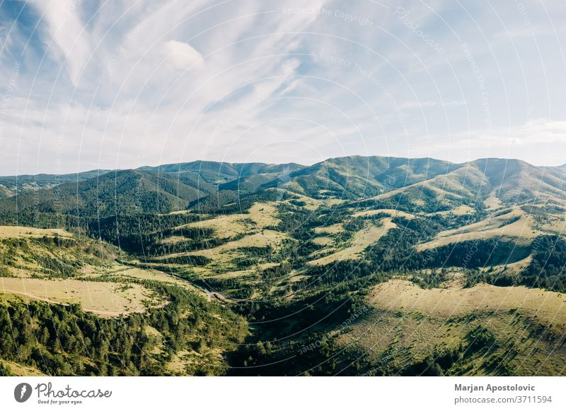 Aerial view of a beautiful mountain range of Zlatibor, Serbia above aerial background cloud clouds environment europe forest grass green high hike hiking hill