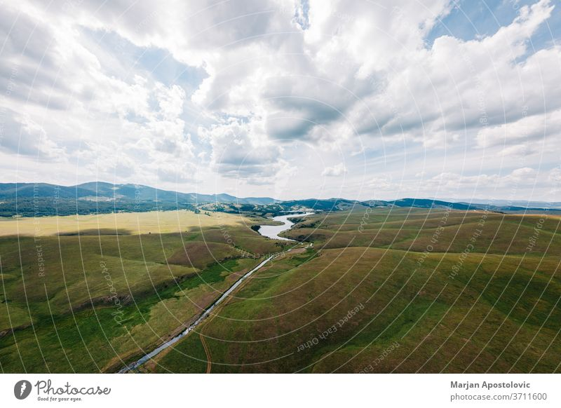 Aerial view of a Ribnicko lake in Zlatibor, Serbia above aerial background beautiful cloud clouds country countryside day environment europe field flying grass