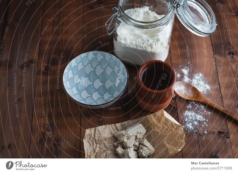 Ingredients and containers for making sourdough Bakery concept. Copy space. Top view. Yeast Water Bowl Paper Sourdough Dough Knead Flour Processing Homemade