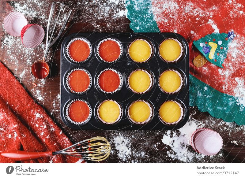 Baking pan with colorful cupcake dough christmas prepare baking pan food kitchen cook pastry homemade creative ingredient recipe culinary cuisine bake xmas