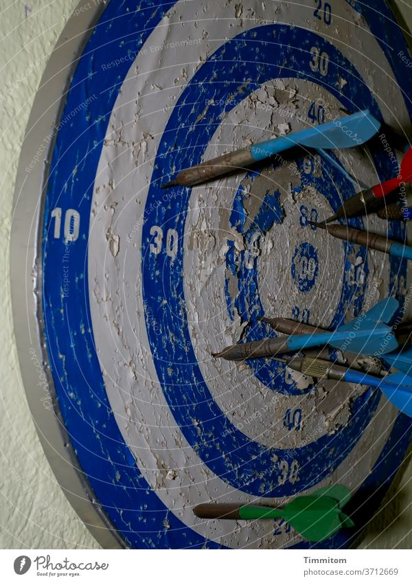 just beside it (update)   even after years of practice Darts Dartboard Wall (building) Old Broken traces of use Arrow Playing Target Leisure and hobbies figures