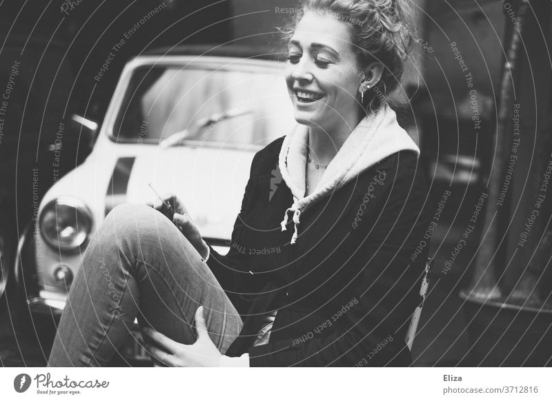 Portrait of a laughing young woman with closed eyes Laughter Joy Woman youthful Vintage car Sit omitted girl Happiness luck Lifestyle portrait smile Closed eyes