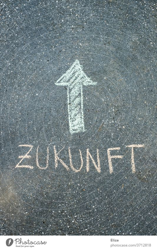 Green arrow pointing upwards with the word future. Chalk on asphalt. Future Advancement Arrow Direction trendsetting Trend-setting Target looking ahead