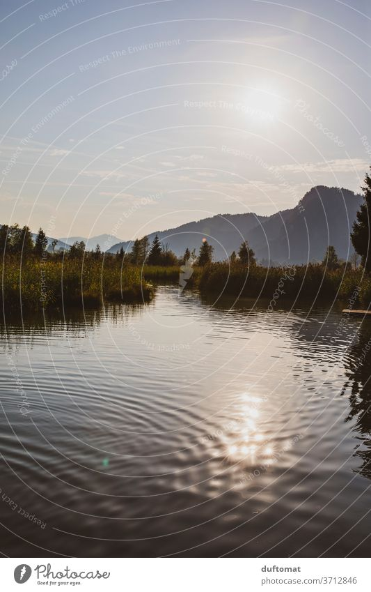 View over the lake, mountains in the background Lake reflection Water Nature Reflection Calm Sky Sunset Smoothness Light Body of water Idyll Dusk Twilight