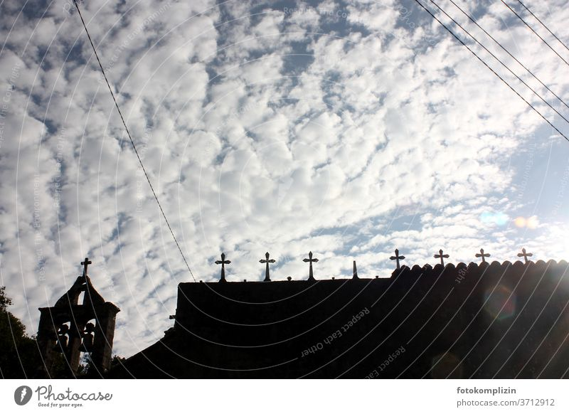 Cemetery crosses as silhouette against clouds sky cemetery wall weaker Death Tombstone Grave Religion and faith Transience Funeral Belief Old Crucifix Crosses