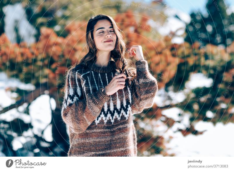 Young woman enjoying the snowy mountains in winter caucasian sweater nature active fashion young beautiful cute beauty girl happiness outdoor smile european
