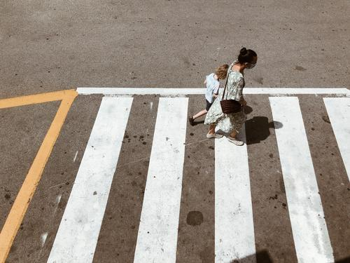 Abbey Road Fake Zebra crossing persons Mother Child Human being Family & Relations Parents Infancy urban Asphalt Walking Town Bird's-eye view Traverse mark