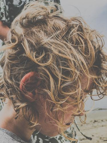 fuzzy head Child hair hairstyle Blonde Curl Curly Hair and hairstyles Face Hairdresser Untidy comb uncombed Muddled Human being Boy (child) Beach bathe Downward