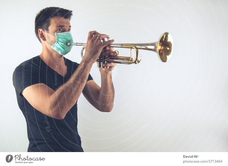 Making music in times of Corona corona coronavirus Musician Wind instrument Respirator mask Mask breathing mask pandemic Virus Healthy Infection Quarantine