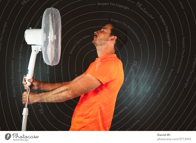 Man holds fan in hands Fan ardor perspire warm Hot Summer Sportsperson Athletic Warmth Air