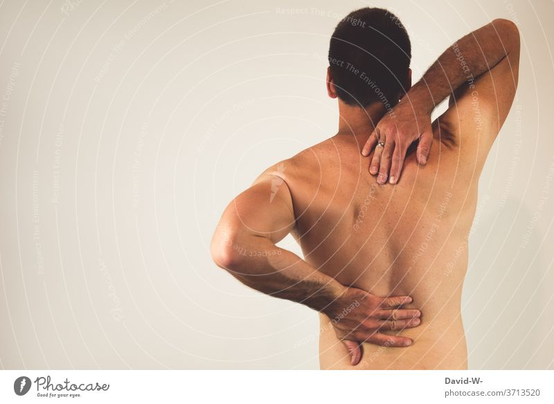 Man with back pain Back pain Pain Human being Colour photo Healthy Health care Adults Spinal column by hand Hurt Therapy Slipped disc intervertebral disc Stress