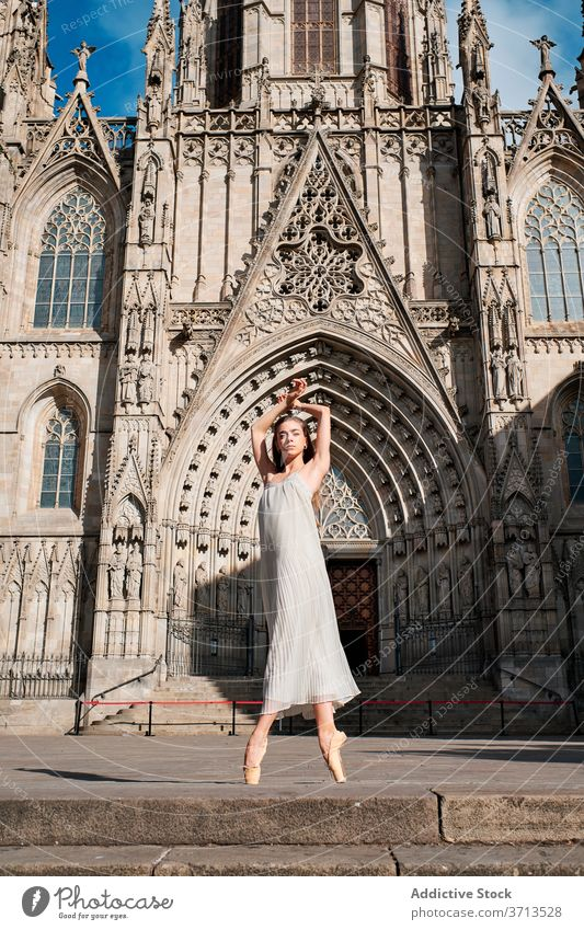 Female ballet dancer performing dance near old cathedral ballerina architecture building historic grace sensual tiptoe woman pose art choreography creative