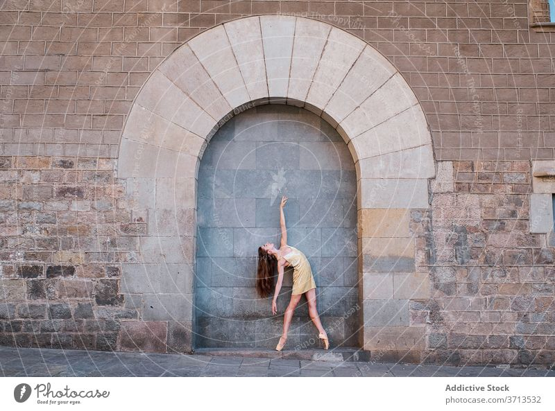 Young ballerina dancing near old building dance wall arch historic grace woman ballet pose aged female dancer art perform choreography creative beautiful