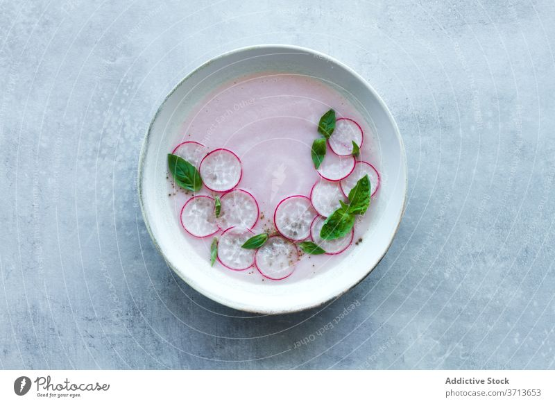 Vegetarian radish soup with green herbs vegetarian vegetable food fresh basil cold bowl meal nutrition healthy tasty cuisine organic homemade delicious natural