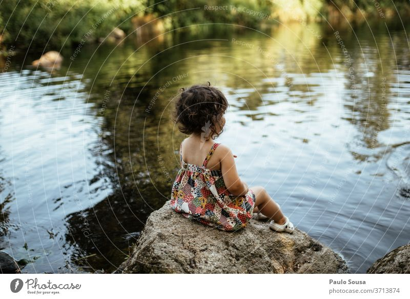 Child sitting on the riverside River childhood Childhood memory Human being Summer Joy Leisure and hobbies Colour photo Toddler Playing Infancy Exterior shot