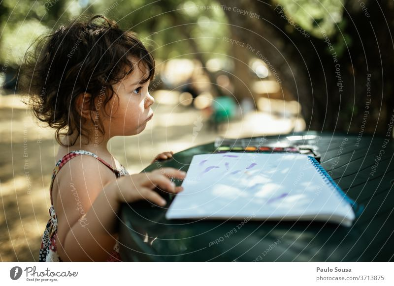 Child reading outdoors childhood Reading Leisure and hobbies Caucasian Happiness Portrait photograph Exterior shot Colour photo Lifestyle caucasian Human being
