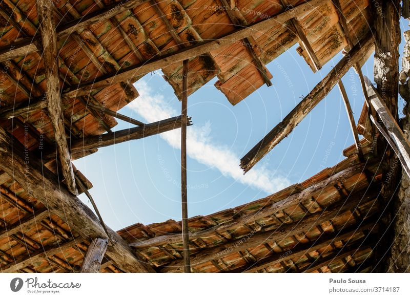 Hole in the roof Roof Roofing tile Ruin Ruined ruins Abandoned Detail Brick Old Blue Architecture House (Residential Structure) Red Deserted Building Sky Stone