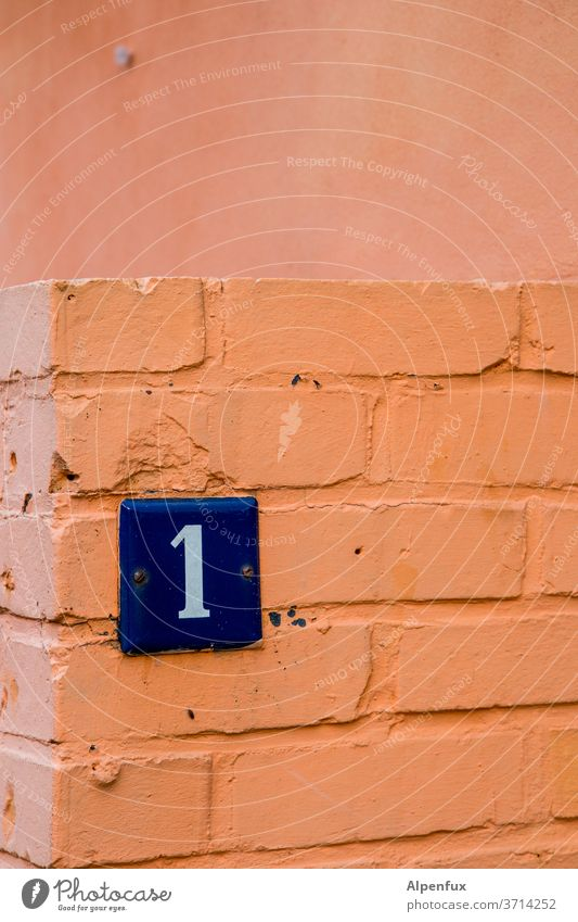 Entry post 1 Digits and numbers Signs and labeling House number Wall (building) Exterior shot Deserted Colour photo Wall (barrier) Facade Day Characters