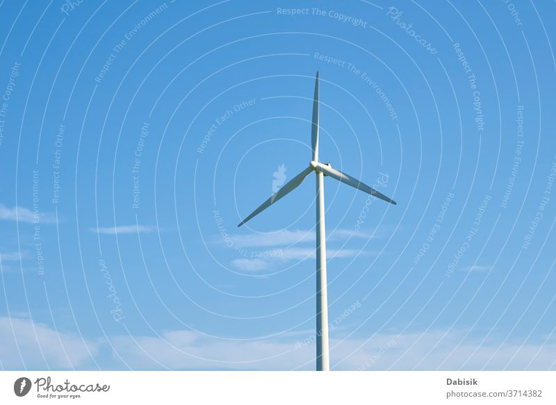Wind turbine against blue sky. Wind power energy concept wind generator industry electricity alternative clean renewable environment technology wind turbine