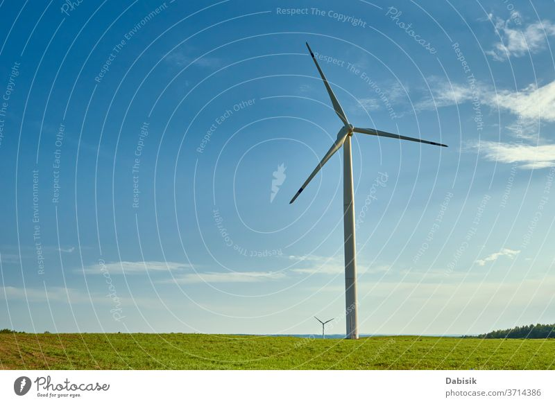 Wind turbine in the field. Wind power energy concept wind generator industry electricity alternative landscape green clean nature renewable environment