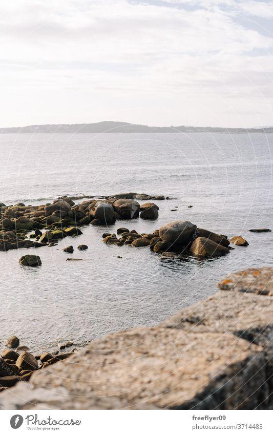 Ocean coast made of large stones and rocks ocean sea nobody copy space horizon scene clean shore coastline breakwater rocky seashore landscape fresh scenic